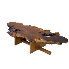 """MIRA NAKASHIMA Coffee table, its free-edge redwood root burl top with single rosewood butterfly key, over black walnut Double Minguren I base, 2004. Signed and dated. 17"""" x 80"""" x 30""""- Estimate: $10,000 - $15,000"""