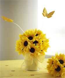 Sunflower Themed Bridal Shower Centerpiece & Table Decorations. Sunflower ball in an aluminum pail with a second ball and sunflower Table Sprinkles that can be personalized with butterflies flitting above. Everything you need for a beautiful sunflower themed table setting!
