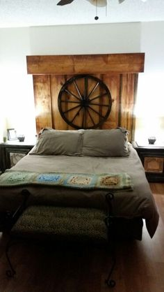 Headboard made from scrap wood and wagon wheel
