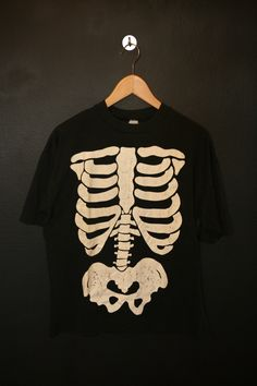 Halloween Skeleton Glow in the Dark 1990's vintage Tshirt. No tag. Please see measurements. This shirt is in great vintage condition, soft and worn in with some fading throughout and some cracking on the graphic. Measurements Pit to Pit: 21.5 Back of Collar to Hem: 26 We do our best to desc