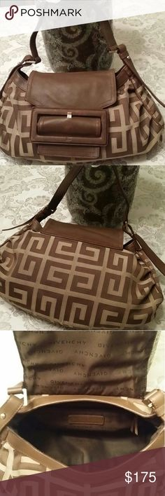 Authentic Givenchy Purse Bag This is a beautiful vintage Givenchy Purse with serial number inside. Gently used in good good condition with little wear to the strap. No rips or tears. 13 x 9 Givenchy Bags Shoulder Bags