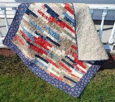 Speedy Strips Layer Cake Race Quilt | FaveQuilts.com