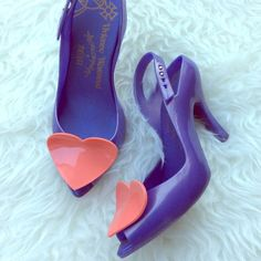 "✨HP✨ Vivienne Westwood Melissa Lady Dragon Heart Excellent used condition authentic Vivienne Westwood Melissa Lady Dragon Heart Violet Heels. Size 7. True to size. 4"" heel. Right shoes insole has lifted a bit, very faint scuffs on plastic near heels that are not noticeable unless holding shoes close up. No trades, offers welcome. Vivienne Westwood Shoes Heels"