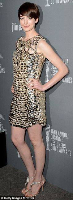 Anne Hathaway wore a Gucci dress and bag, Julieri studs, and Dana Rebecca bangles.