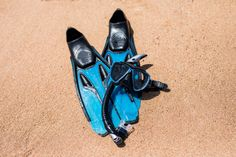 beach vacation fun snorkel equipment on sand with ocean waves water