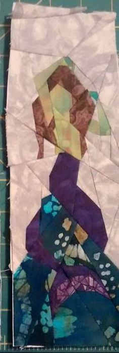 """Fandom In Stitches: Harry Potter: Stained Glass Mermaid.  By Gretchen  Kohlhaas. Tested by Laura Shaffstall  3"""" by 10"""" Paper Pieced.  Free from fandominstitches.com.  Free for personal and non-profit use only"""