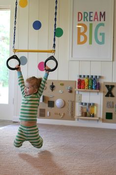 Lots of great playroom ideas (no noisy electronic toys!).  Rings mounted on ceiling, a custom Lego table, etc.!