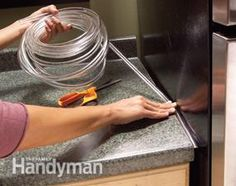 To prevent crumbs and other items from falling into a hard-to-reach spot, fill the gap between your fridge and countertop with nearly invisible plastic tubing.