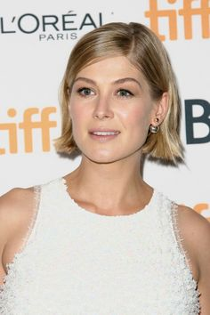 And gaze upon the effortless way her hair is tucked behind her ears. | 21 Times Rosamund Pike Proved That Short Hair Is A Work Of Art