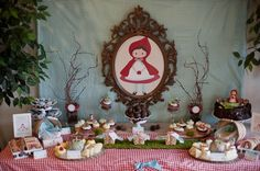 The main dessert area was flanked withlarge artificial trees. Tall vessels were filled with pinecones & long willowy branches. Accents of moss, wood, pinecones and berries were used throughout. Lots of natural elements like bird nests, bundled sticks, large and small apple baskets and such were used to add interest to the display.