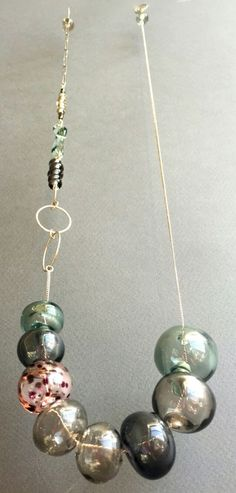Terri Rau, Long Necklace 3 || Sterling silver, lampworked glass, free floating hollow beads