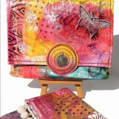 Purse made of canvas painted with acrilics colours by 14 creative hands. Stamped and sewed. (in Italian and English)