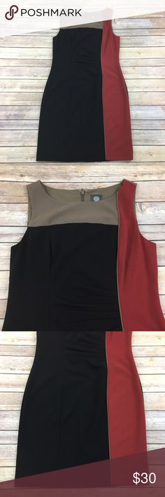 Office ready black Color Block Shift Dress Vince Camuto black and red color block shift dress. Good condition. Measures about 37 inches around the bust, about 33 inches around the waist and is about 36 inches long. Vince Camuto Dresses