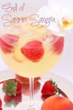 Strawberry Peach Sangria Recipe oh this is perfect for a Girls Night In party @sweetlychicdes