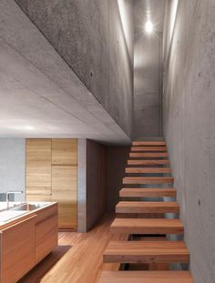 #Beautiful open #stair treads in this #modern #home with #concrete walls and ceiling.