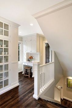 open doorway and stairs? or glass door?   Hall with built ins and open basement staircase - logan's hammer