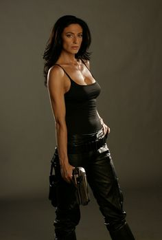 """Claudia Black as either Aeryn Sun in """"Farscape"""" OR Vala Mal Doran in """"Stargate.""""  I'm sure the gun makes in a no brainer for some fans...but MY memory isn't THAT good ;-)"""