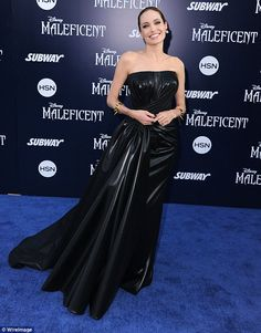 Making major money: Angelina looked glamorous at the premiere of Maleficent in 2014; the Disney film was her highest grossing ever