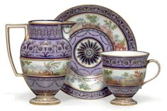 A SEVRES PORCELAIN LAVENDER-GROUND BALUSTER CUP AND SAUCER AND A HOT-MILK JUG DATE CODE A3 FOR 1795, SCRIPT SEVRES MARK AND WITH THE FRENCH REPUBLIC MONOGRAM, PAINTERS' MARKS FOR NOEL AND POSSIBLY FOR BOUILLAT PERE, THE CUP AND SAUCER INCISED 41