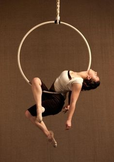 This is one of my favorite rest poses on trapeze and lyra!  It's nice to roll in and out of.