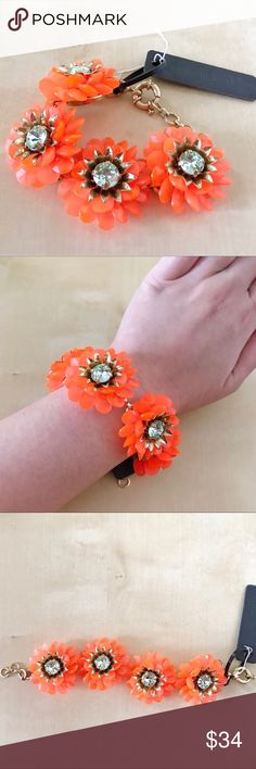 """NWT J. Crew Acrylic Brass Flower Bracelet NWT J Crew Sample Flower Bracelet in neon orange acrylic and brass finish material. Clasp closure with acrylic 4 flower with rhinestone crown set in the center. 7"""" total length measured flat. This is a sample piece never worn before, and not in store. J. Crew Jewelry Bracelets"""