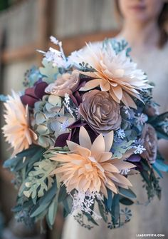 DIY paper bouquet which would be stunning for a wedding or placed in a vase as a centerpiece. To create your own rustic bouquet head over to Lia Griffith for the free template that you can cut using your Cricut to make your own bouquet filled with a variety of textures and colored plants including dahlia, ranunculus, Queen Anne's lace, hydrangea, eucalyptus, and succulents.