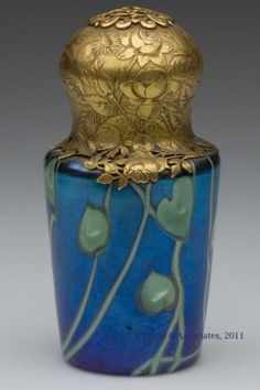 "iamlookingbackatyou:    TIFFANY FAVRILE perfume bottle with ormolu top  (via ART NOUVEAU / Tiffany Favrile perfume with ormulu decorated lid, 4"" tall)"