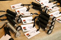 """Love this idea for a Bar Bat Mitzvah """"camp"""" theme. Place cards with flashlights attached. Dual purpose!"""
