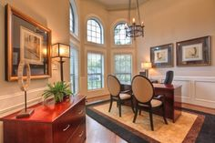 A dream home office--love the windows, the wainscoting, the guest chairs, and the file cabinet.