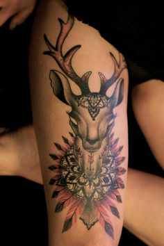 Tattoo artist Dodie adds spiritual symbolism to this tattoo of a deer by adding mandalas and feathers
