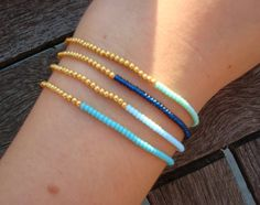 Simple Stretchy Seed Bead Bracelet Gold and Blue by cocolocca