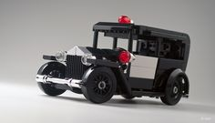"https://flic.kr/p/haxLzo | Lego 1930 Ford Model A – Police _02 | Lego Ford Model A (police version above), built as contribution to Thorsten's (Xenomurphy) ""Arkham Asylum"" MOC.   You can check more pictures in my photostream, but much more important, make sure you pay a visit to Thorsten's photostream to check his awesome ""Arkham Asylum"" in all its magnificent glory!   –   My Ford Model A comes as: Police car / Ambulance / Civilian sedan / Civilian wagon"