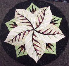 Poinsettia, Quiltworx.com, Made by CI Elizabeth Chadwick Table Topper Patterns, Table Toppers, Elizabeth Chadwick, Foundation Paper Piecing, Poinsettia, Fabric Design, Quilt Patterns, Plant Leaves, Quilts