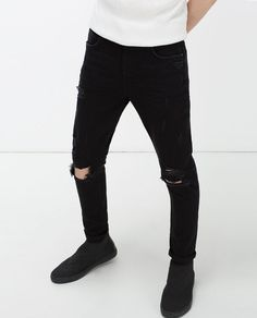 NEW CARROT FIT JEANS WITH RIPS