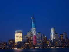 """Lower Manhattan mid June at dusk. Freedom Tower decked out in colors for """"Flag Day"""""""