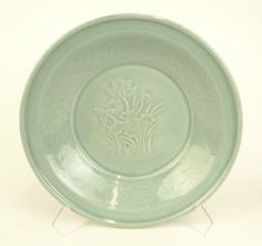Chinese Celadon Glaze Porcelain Shallow Bowl with Raised Water Lily Decoration. Unsigned. Good to Very Good Condition. Measures 2-5/8 Inches Tall and 12 Inches Diameter.