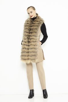 Natural vest for women. The long collar of this vest is made from natural fox/raccoon fur having a special and modern design.