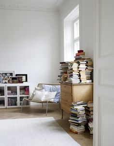 I've been searching Pinterest for months for the perfect bookshelf to pin to my ideal, phantom home. Unfortunately, I must admit that I have always and always will store my books exactly like this. I can't stand them on their spines. It feels too harsh.