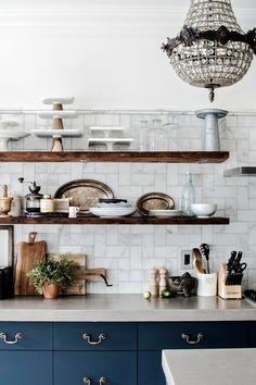 Favorite Kitchens of 2015 - Via House Of Hipsters Blog Chandeliers in unexpected places are always fun! I love this overly feminine chandelier lighting this this kitchen.