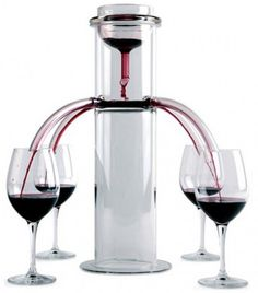 I WANT ONE!!! The wine pourer is a brilliant piece of design that turns pouring a glass of wine into a piece of performance theater. This is the perfect center piece for a dinner party, although clearly this is limited to just four glasses at a time.  From Liquid Engineering for the Modern Kitchen.