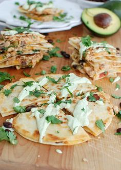 Mexican Salmon Quesadillas with Avocado Cream Sauce are a healthy, simple and light lunch that offers protein, omega-3s and brings together your favorite Mexican flavors. Salmon is mixed with salsa, black beans and cheese and is heated between two tortillas and topped with an avocado cream sauce and freshly chopped cilantro.// A Cedar Spoon #ad