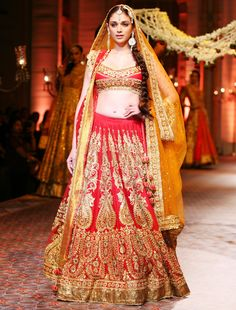 Aditi Rao Hydari in http://PreetiSKapoor.com/ Crimson Red Lehenga, Gold Embroidery's with antique look  @ Aamby Valley India Bridal Fashion Week (Dec) 2013