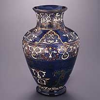 The 'Cavour Vase' is one of a small group of cobalt-blue & purple enamelled & gilded glass vessels made in Syria & Egypt during the 13th & 14th centuries. As such, this object is remarkable not only for the remarkable richness of its decoration, but also for its historical significance. Although an inscription around the neck gives praise to the sultan, this ruler is not named; elsewhere, the vase is decorated with vegetal motifs & Chinese-style birds.