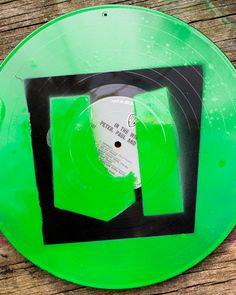 vinyl record album upcycled using spray paint stencils