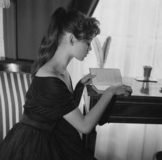 Brigitte Bardot reads in Paris, 1955.