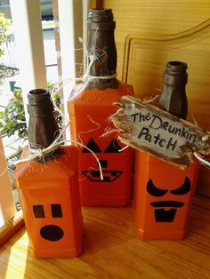"""My spin on the wine bottle pumpkin- made from 3 different sizes of Jack Daniels bottles (empty of course!) and the signage reads """"The Drunkin Patch"""" ;)"""