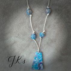 Handmade pendant made of cold porcelain