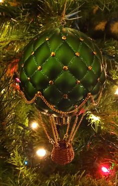 Hot air balloon Christmas ornament.  EPBOT... upside down ornament crafted into the balloon. Chains then a basket. Love this!