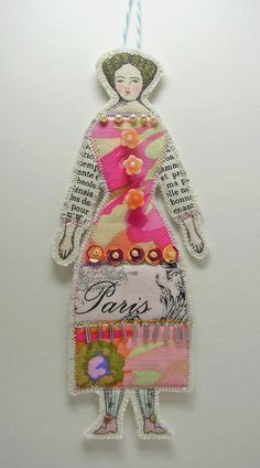 This Fabulous little flat cloth doll is just about 5 1/2 inches tall from the top of her head to the bottom of her shoes.  The face, hands and shoes of this cloth (paper doll like) ornament is made from an original drawing of mine printed on cotton fabric that I appliqued other cotton fabrics to. Then I appliqued it onto natural colored cotton batting and layered her with more cotton batting and cream cotton fabric.  I sewed her together with a few extra steps with the last one being an ...