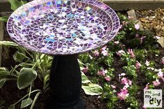 Breaking CDs up into small pieces of various shapes, this blogger glued her shattered them onto a weathered birdbath for her yard, giving it a much shinier makeover. Get the tutorial at Me and My DIY »